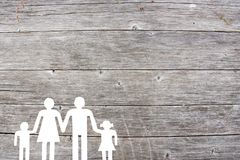 Family on a wooden background welfare concept.  Royalty Free Stock Photos