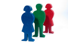 Family of wooden figures. Colorful family of wooden figures, father, mother and daughter, isolated on white background Royalty Free Stock Photo