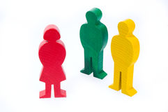 Family of wooden figures. Family of colorful wooden figures isolated on white background Royalty Free Stock Photos