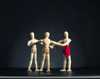 Family of wooden figures in circle Stock Image