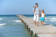 Family on wooden jetty Stock Photography