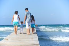 Family on wooden jetty. Royalty Free Stock Photos
