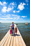 Family on wooden pier Royalty Free Stock Images