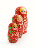 Family of wooden toys. Group of wooden dolls, painted in black, white background Stock Images
