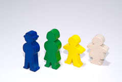 Family of wooden toys on white isolated background Stock Photo