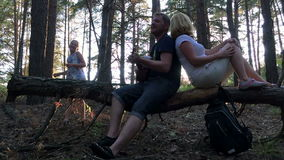 The family in the woods playing guitar stock footage