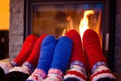 Family in woolen sock warming feet stock photography