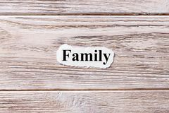 Family of the word on paper. concept. Words of Family on a wooden background.  stock photos