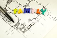 Family word and pen on blueprints and floor plan, architecture Stock Photography