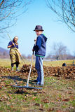 Family at work in an orchard Royalty Free Stock Photos