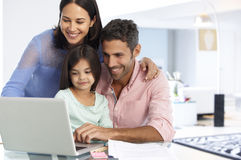 Family Working At Laptop With In Home Office Royalty Free Stock Photo