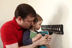 Family working with screwdriver Royalty Free Stock Images