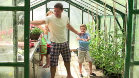 Family Working Together In Greenhouse stock video footage