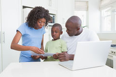 A family working and using his computer Royalty Free Stock Photography