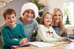 Family Writing Christmas Cards Together Royalty Free Stock Images