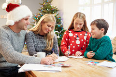 Family Writing Christmas Cards Together Stock Photos