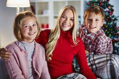 Family on xmas evening Royalty Free Stock Photos
