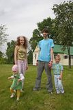Family in yard Royalty Free Stock Photography