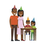 Family Yogrther at Table with Happy Birthday Cake. Boy sitting at table with birthday decorated cake with candles and elder girls stands near. Mother and father Stock Photos