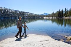 Family in yosemite. Family of two, father and son, walking and enjoying beautiful tenaya lake at tioga pass in yosemite national park, active vacation concept Stock Images