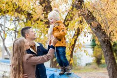 A family with a young boy in the autumn forest walk. 1 Stock Photo