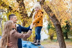 A family with a young boy in the autumn forest walk Stock Photos