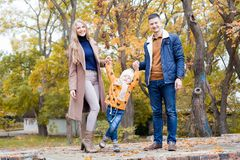 A family with a young boy in the autumn forest walk. 1 Stock Image