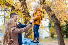 A family with a young boy in the autumn forest walk. 1 Royalty Free Stock Photos
