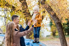 A family with a young boy in the autumn forest walk. 1 Stock Images