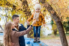 A family with a young boy in the autumn forest walk. 1 Stock Photos