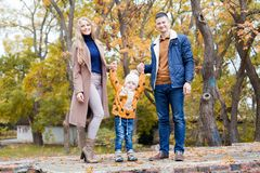 A family with a young boy in the autumn forest walk. 1 Royalty Free Stock Images