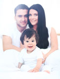 Family with young children to bed in the bedroom Royalty Free Stock Photo