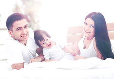 Family with young children to bed in the bedroom Royalty Free Stock Image