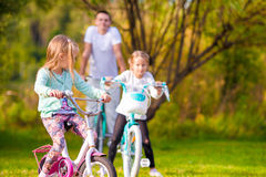 Family of young father and little kids biking at. Family of father and kids biking at summer vacation Stock Photo