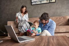 Family - Parent spending happy time at home with their baby son. Family - Young parent spending happy time at home with their baby son stock photography