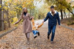 A family with a young son walk in the Park in autumn royalty free stock photo