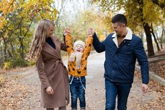 A family with a young son walk in the Park in autumn stock photos