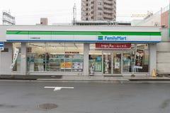 FamilyMart une épicerie de mot est le tiers - plus grand sur 24 marchés commodes de boutique d'heure, Photo stock
