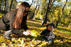 Familyy in the park in autumn stock images