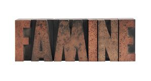Famine. The word 'famine' in old, ink-stained wood type Stock Photography