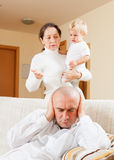Famity having quarrel. Family quarrel. Grandmother having problems with her son at home Royalty Free Stock Image