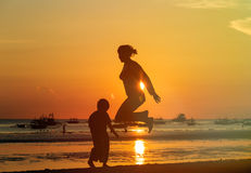 Famiy jumping at sunset Royalty Free Stock Photography