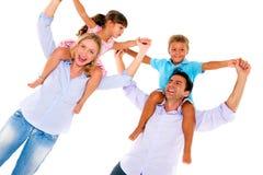 Família com duas crianças Fotos de Stock Royalty Free