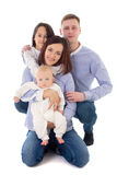 Família feliz - assento do pai, da mãe, da filha e do filho isolados Imagens de Stock Royalty Free