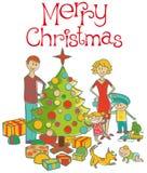 Família feliz que veste acima a árvore de Natal Fotos de Stock Royalty Free