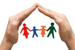 Família na casa feita das mãos isoladas Fotografia de Stock
