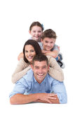 Família que encontra-se sobre se Fotografia de Stock