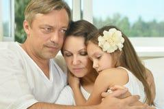 Família triste com menina Fotografia de Stock