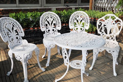 Famlily garden table and chairs Royalty Free Stock Photos