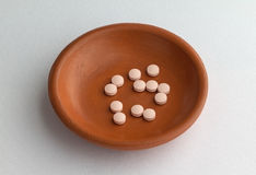 Famotidine tablets in a small bowl on table Royalty Free Stock Photography